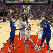 03 February 2018: The San Diego State Aztecs look to rebound after a couple losses against Air Force Saturday night. San Diego State Aztecs guard Jeremy Hemsley (42) lays the ball up in between Air Force Falcons forward Lavelle Scottie (12) and forward Ryan Swan (34) in the second half. The Aztecs beat the Falcons 81-50 at Viejas Arena.<br /> More game action at www.sdsuaztecphotos.com