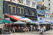 HONG KONG, CHINA - SEPTEMBER 16, 2012: Unidentified tourists visit restaurants at lunchtime in  Stanley town in Hong Kong, China. Stanley town is a tourist attraction in Hong Kong.