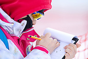 Official checks the start list during 2013 Special Olympics World Winter Games PyeongChang at Cross Country Skiing Venue on January 30, 2013...South Korea, PyeongChang, January 30, 2013..Picture also available in RAW (NEF) or TIFF format on special request...For editorial use only. Any commercial or promotional use requires permission...Photo by © Adam Nurkiewicz / Mediasport