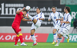 LLANELLI, WALES - Wednesday, August 15, 2012: Bosnia-Herzegovina's Sejad Salihovic and Wales' Sam Vokes during the international friendly match at Parc y Scarlets. (Pic by David Rawcliffe/Propaganda)