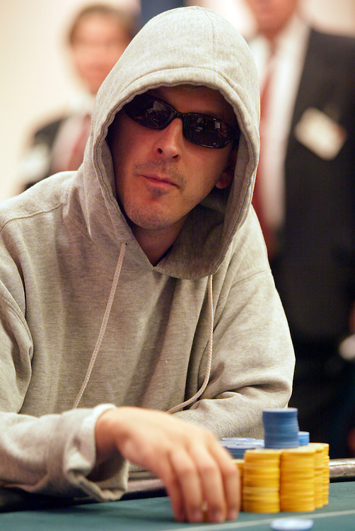 "September 1, 2003: Phil Laak, aka ""The Unibomber"", keeps his face and eyes covered to prevent others from reading anything into his body language or eyes at the World Poker Tour event at the Bicycle Club in Los Angeles."