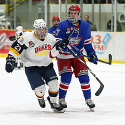 WELLINGTON, ON - JANUARY 25: Jacob Thousand #23 of the Wellington Dukes and Tanner McEachern #27 of the Oakville Blades skates up ice in the first period on January 25, 2019 at Wellington and District Community Centre in Wellington, Ontario, Canada.<br /> (Photo by Ed McPherson / OJHL Images)