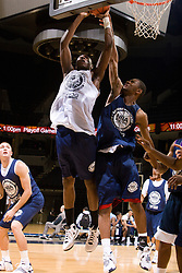 WF Shawn Williams (Duncanville, TX / Duncanville) blocks a shot by C/F Cadarian Raines (Petersburg, VA / Petersburg).  The NBA Player's Association held their annual Top 100 basketball camp at the John Paul Jones Arena on the Grounds of the University of Virginia in Charlottesville, VA on June 20, 2008