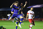 Callum Howe jumps during the The FA Cup match between Solihull Moors and Rotherham United at the Automated Technology Group Stadium, Solihull, United Kingdom on 2 December 2019.