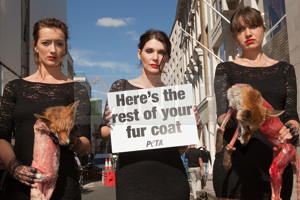© under license to London News Pictures. 25/06/12..Anti-fur protest by animal rights group Peta. Three models on New Bond Street wearing black dresses and spiked heels hold the corpses of dead foxes. The protest comes on the eve of London Fashion Week...ALEX CHRISTOFIDES/LNP