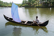 Fishing in the backwaters, India, Kerala, a state on the tropical coast of south west India