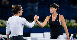 February 21, 2019 - Dubai, ARAB EMIRATES - Simona Halep of Romania & Belinda Bencic of Switzerland at the net after their quarter-final match at the 2019 Dubai Duty Free Tennis Championships WTA Premier 5 tennis tournament (Credit Image: © AFP7 via ZUMA Wire)