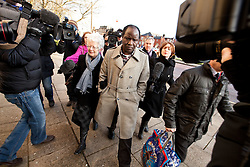 © Licensed to London News Pictures. 26/01/2012. Bolton, UK. The Reverend Canon John Magumba arrives at Bolton Crown Court for sentencing following pleading guilty to conspiring to facilitate a breach of UK immigration law after performing 31 bogus weddings in Rochdale churches. Photo credit : Joel Goodman/LNP