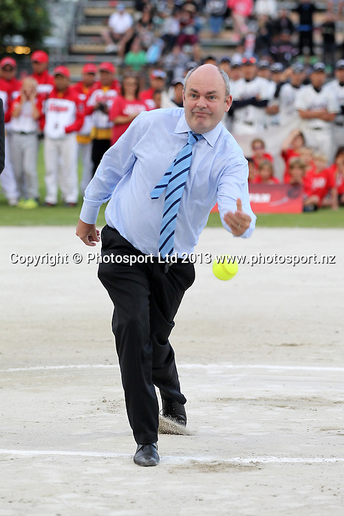 Minister for Economic Development Steven Joyce takes the first pitch at Mark Sorenson at the World Mens Softball Championships opening ceremony at Rosedale Park, Albany, Auckland. Photo: Fiona Goodall/photosport.co.nz