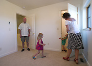 PRICE CHAMBERS / NEWS&amp;GUIDE<br /> Jim and Lisa Wolfgang show their twin daughters Isabella and Sophi their new room, upstairs in their new Teton Village home.