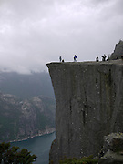 tourists at Preikestolen, or Pulpit Rock, above Lysefjorden, Forsand, Rogaland, Norway.