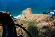 Honopu Valley and remote beaches on the Pacific Ocean seen via helicopter over Kauai's Na Pali Coast, Hawaii, USA.