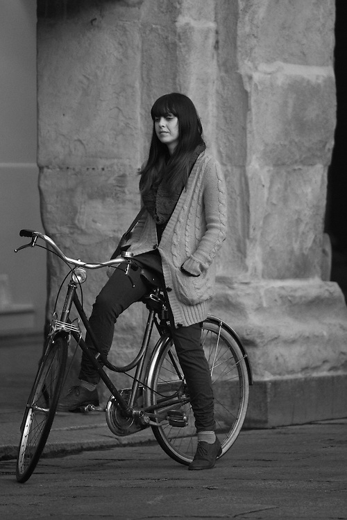 Woman on bike. Black and photograph from Bologna.