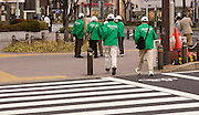 Race volunteers preparing at the 22km point in the annual Nagoya Women's Marathon, which was held in the heart of the city with over 15,000 entrants.