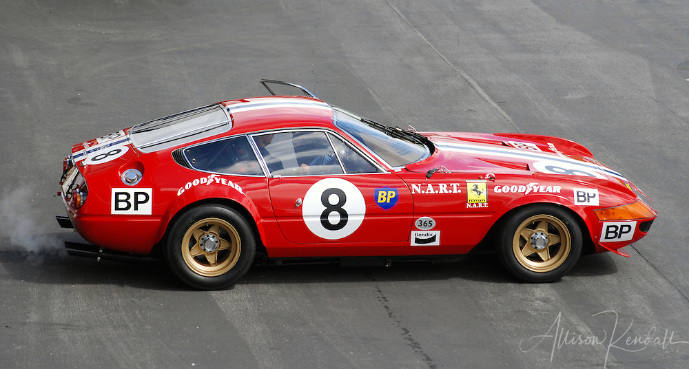 Classic red Ferrari, race-ready at Laguna Seca