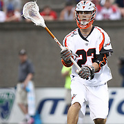 Drew Snider #23 of the Denver Outlaws passes the ball during the game at Harvard Stadium on May 10, 2014 in Boston, Massachusetts. (Photo by Elan Kawesch)
