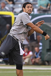 Aug 26, 2012; East Rutherford, NJ, USA; New York Jets quarterback Mark Sanchez (6) throws a pass during warmups for their game against the Carolina Panthers at MetLife Stadium.