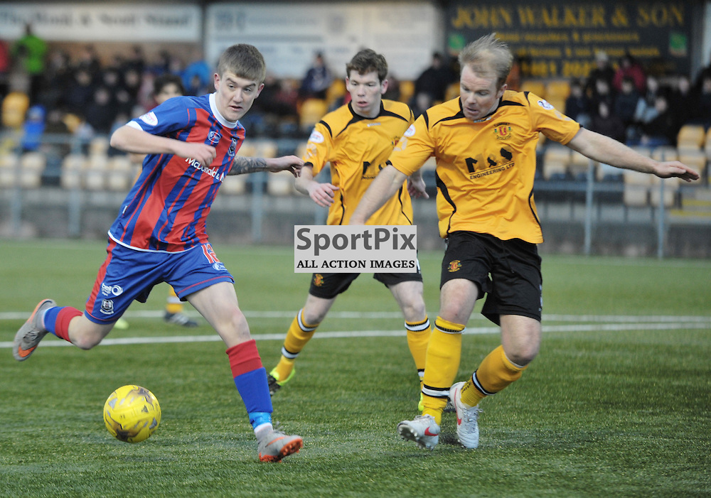 Kyle Macleod (Elgin City, blue &amp; red) and Bryan Gilfillan (Annan Athletic, amber &amp; black) <br /> <br /> Annan Athletic v Elgin City, SPFL League 2, 30th January 2016<br /> <br /> (c) Alex Todd | SportPix.org.uk
