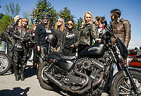 Donna Lucas and Cindy Grasso are among to group joining Samantha Campana, Leticia Cline, Lilly James and Kissa Von Adams of the Orlando Iron Lilies for their group ride to the Kancamagus Highway from Laconia Harley Davidson on Tuesday morning.    (Karen Bobotas/for the Laconia Daily Sun)