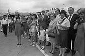 1983-15-08.15th August 1983.15-08-1983.08-15-83..Photographed at Dublin Airport..Pressed:..An Irish welcome for gold medalist Eamonn Coughlan on his return from the World Athletic Championships in Helsinki, Finland. His mother Kathleen, wife Yvonne and chldren Suzanne (four) and Eamonn Jn await him. ..