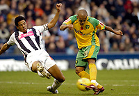 Photo: Leigh Quinnell.<br /> West Bromwich Albion v Norwich City. Coca Cola Championship. 11/11/2006. Norwichs' Robert Earnshaw has his goalbound shot blocked by West Broms Curtis Davies.
