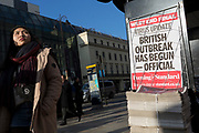 On the day that the UK Government's Chief Scientific Advisor, Sir Patrick Vallance said that the Coronavirus Covid-19 outbreak was now spreading person to person in the UK, Londoners walk past the latest news headline from the capital's London Evening Standard newspaper outside Charing Cross railway station, on 6th March 2020, in London, England.