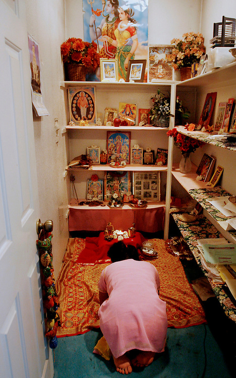 Shanta worships in a room dedicated to the Hindu gods in her Riverside home. Now considered an adult, Shanta is more conscious of her roles and responsibilities. .