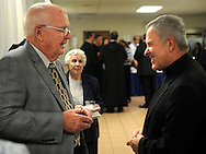 The Most Rev. Robert J. Carlson (right) visits St. Justin Martyr parishioner Jim Steck during the reception following a Mass of Ordination to the Diaconate where Brother Francis Hein, OSB, and Brother Cassian Koenemann, OSB, became transitional Deacons at the Church of the Abbey of Saint Mary and Saint Louis in Creve Coeur, Mo. Saturday, Aug. 11, 2012. Steck is the nephew of Bishop Leo J. Steck, deceased Auxiliary Bishop of Salt Lake City. Photo © copyright 2012 Sid Hastings.