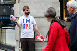 © Licensed to London News Pictures. 23/06/2016. London, UK. Britain Stronger In Europe campaigners hand out leaflets and stickers to voters on the polling day of the EU referendum, 23 June 2016 in central London. Photo credit: Tolga Akmen/LNP