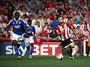 Alan Judge powering away from Josh Emmanuel during the Sky Bet Championship match between Brentf and Ipswich Town at Griffin Park, London, England on 8 August 2015. Photo by Matthew Redman.
