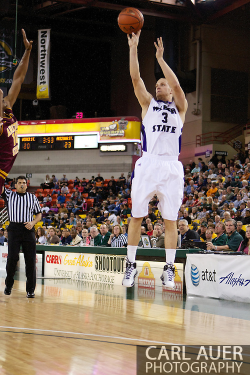 November 26th, 2010:  Anchorage, Alaska - Weber State forward Kyle Bullinger (3) attempts a three point shot in the Wildcats 58-59 loss to Arizona State at the Great Alaska Shootout.