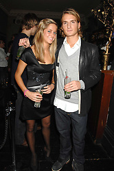 OLLIE PROUDLOCK and TASH MARMONT at a leaving party for Poppy Delevigne who is going to New York to persue a career as an actress, held at Chloe, Cromwell Road, London on 25th January 2007.<br />