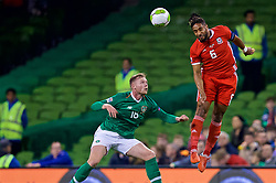 DUBLIN, IRELAND - Tuesday, October 16, 2018: Wales' captain Ashley Williams (R) and Republic of Ireland's Aiden O'Brien during the UEFA Nations League Group Stage League B Group 4 match between Republic of Ireland and Wales at the Aviva Stadium. (Pic by David Rawcliffe/Propaganda)