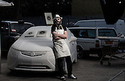 Artist Gavin Turk poses with aVauxhall car cover in canvas for the art car boot fair on Sunday 8 June 2014. <br /> photos by Ki Price