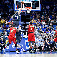 25 February 2017: Orlando Magic forward Aaron Gordon (00) goes for the dunk over Orlando Magic guard Mario Hezonja (8) and Atlanta Hawks center Dwight Howard (8) during the Orlando Magic 105-86 victory over the Atlanta Hawks, at the Amway Center, Orlando, Florida, USA.