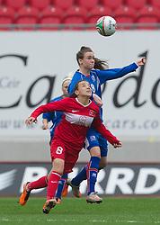 LLANELLI, WALES - Thursday, March 31, 2011: Iceland's Katrin Asbjornsdottir and Turkey's Gülbin Hiz during the UEFA European Women's Under-19 Championship Second Qualifying Round (Group 3) match at Parc Y Scarlets. (Photo by David Rawcliffe/Propaganda)
