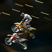January 8, 2014 - New York, NY : Nitro Circus, an action/extreme sports show starring Travis Pastrana, made its Madison Square Garden debut in Manhattan on Wednesday night. Pictured here, Nitro Crew motocross riders including Travis Pastrana, in foreground on yellow bike, warm up before the show. CREDIT : Karsten Moran for The New York Times **SEE LICENSING  RESTRICTIONS IN INSTRUCTION FIELD**