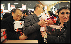 Shoppers buy bargains inside Harrods at the Harrods Christmas Sale begins today, Tuesday December 27, 2011. Photo By Andrew Parsons/i-Images
