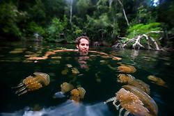 Martin Cavada swims neck deep in a lake filled with jellyfish. Good Call?<br /> Raja Ampat, Indonesia