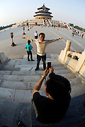 Tiantan (Temple of Heaven). Tourists taking souvenir photos with mobile phones.