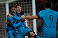 LONDON, ENGLAND - Tuesday, February 23, 2016: Barcelona's Lionel Messi celebrates scoring the first goal against Arsenal with team-mates Neymar and Luis Suárez during the UEFA Champions League Round of 16 1st Leg match at the Emirates Stadium. (Pic by Kirsten Holst/Propaganda)