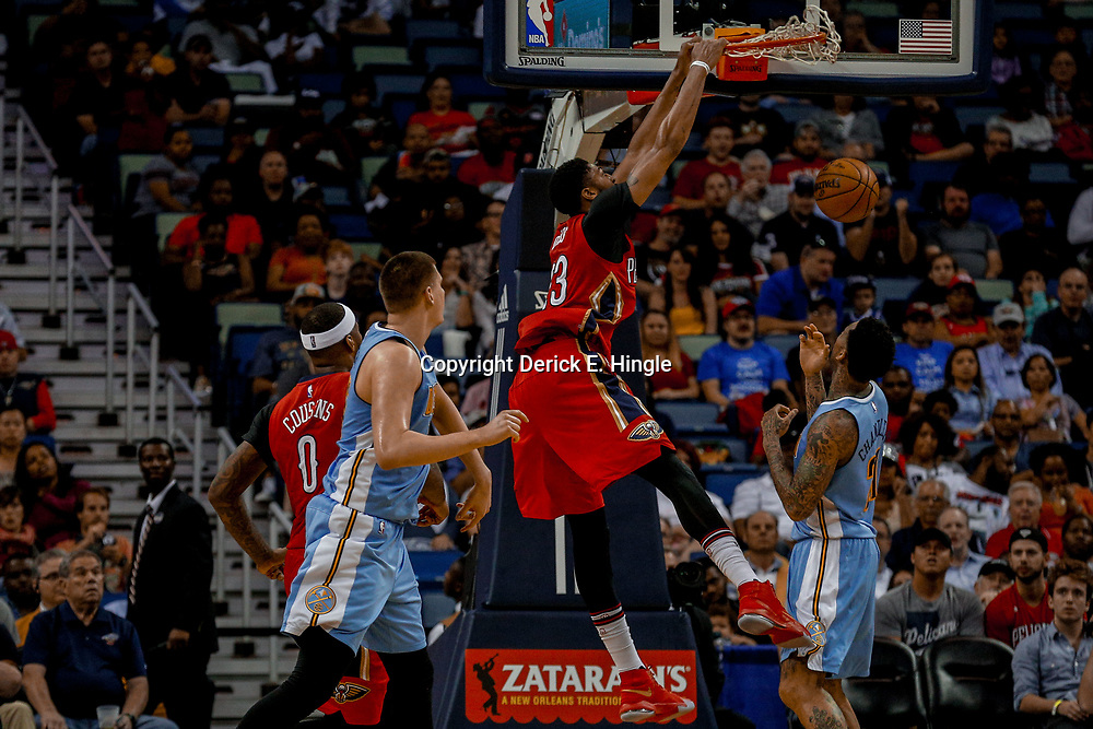 Apr 4, 2017; New Orleans, LA, USA; New Orleans Pelicans forward Anthony Davis (23) dunks over Denver Nuggets forward Wilson Chandler (21) during the second quarter of a game at the Smoothie King Center. Mandatory Credit: Derick E. Hingle-USA TODAY Sports