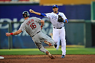 June 28, 2008 - Kansas City, MO..Shortstop Mike Aviles (30) of the Kansas City Royals throws to first base for a double play in the fourth inning over Chris Duncan (16) of the St. Louis Cardinals at Kauffman Stadium in Kansas City, Missouri on June 28, 2008...The Cardinals defeated the Royals 5-1.  .Peter G. Aiken/CSM