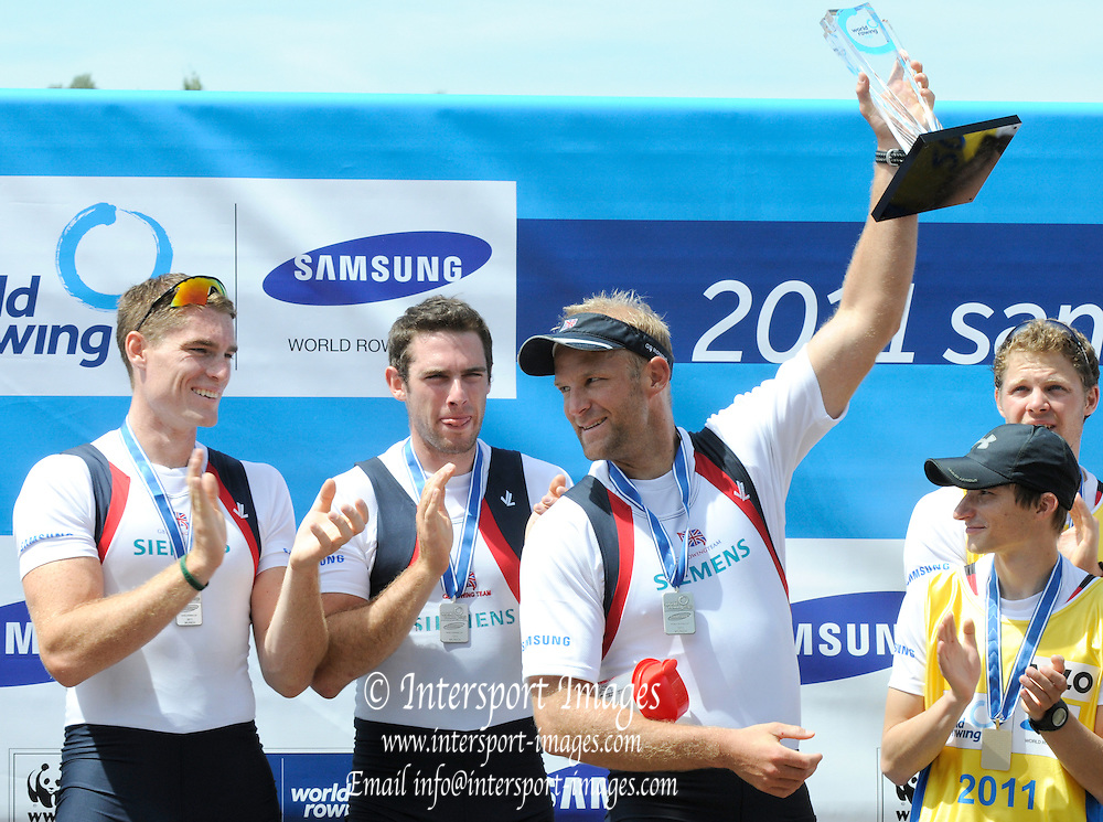 Munich, GERMANY,  Alex PARTRIDGE, holds aloft  the  Munich FISA World Cup presented for the nation with the highest points scored at the reagatta on the FISA world Cup Rd 1. Munich Olympic Rowing Course,  Sunday  29/05/2011  [Mandatory Credit Peter Spurrier/ Intersport Images]