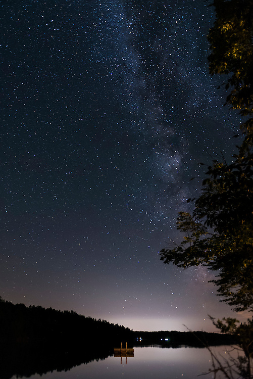 A landscape view of the Milky Way and starry night above Buck Lake, which is North of Kingston Ontario, Canada.
