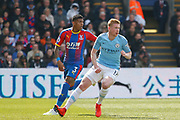 Manchester City midfielder Kevin De Bruyne (17) and Crystal Palace defender Patrick van Aanholt (3) during the Premier League match between Crystal Palace and Manchester City at Selhurst Park, London, England on 14 April 2019.