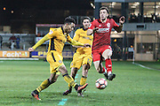 Niall Heaton of Alfreton Town charges down a Jazzi Barnum-Bobb of Newport County clearence during the The FA Cup match between Newport County and Alfreton Town at Rodney Parade, Newport, Wales on 15 November 2016. Photo by Andrew Lewis.