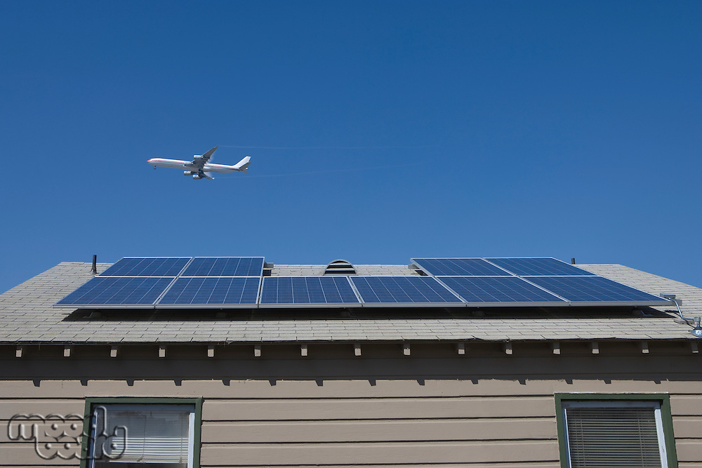 Aeroplane and rooftop with solar array Inglewood Los Angeles California