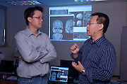 18317College of Engineering Lab shots .Shuisheng Xie(left), ..Carlo Chung(MIddle), Jundong Liu (right), Teacher..18317College of Engineering Lab shots .Jundong Liu's lab (brain scan imaging)...meet at his office...Stocker 321A