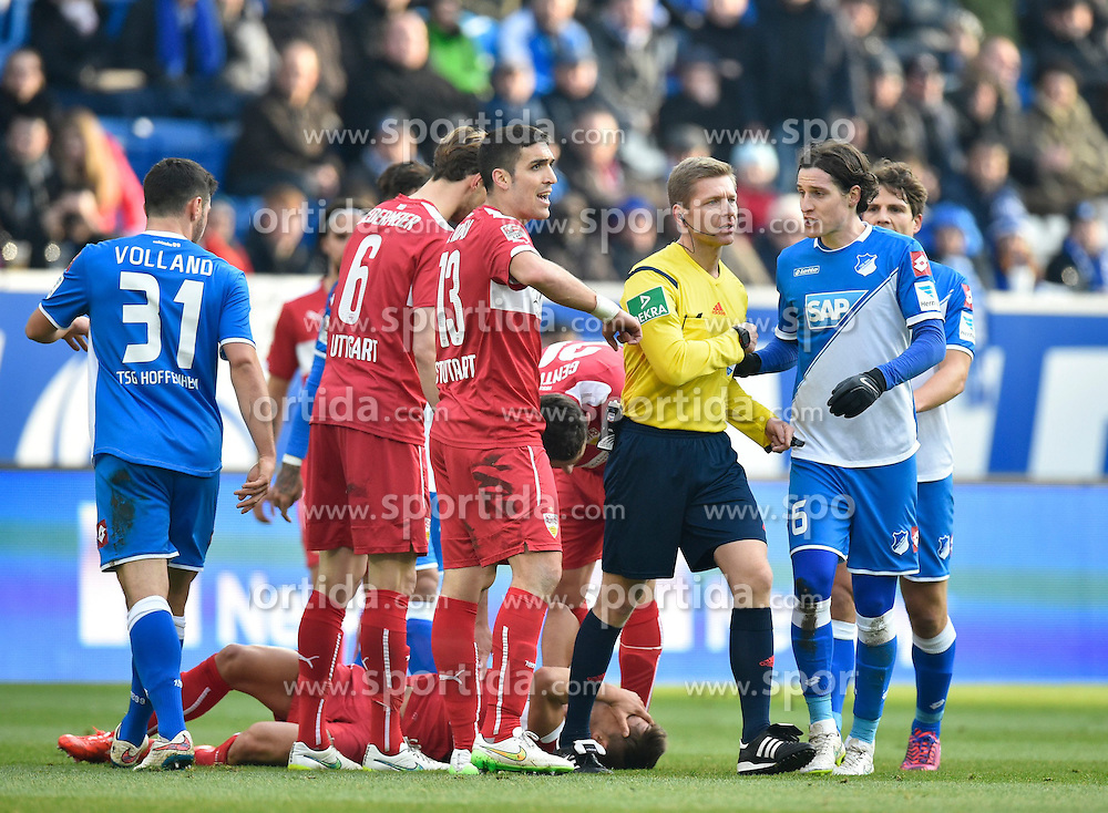 14.02.2015, Rhein Neckar Arena, Sinsheim, GER, 1. FBL, TSG 1899 Hoffenheim vs VfB Stuttgart, 21. Runde, im Bild Schiedsrichter Tobias Welz, zueckt gelbe Karte Gelb Verwarnung gegen Sven Schipplock TSG 1899 Hoffenheim nach dessen Foul gegen Moritz Leitner VfB Stuttgart am Boden // during the German Bundesliga 21th round match between TSG 1899 Hoffenheim and VfB Stuttgart at the Rhein Neckar Arena in Sinsheim, Germany on 2015/02/14. EXPA Pictures &copy; 2015, PhotoCredit: EXPA/ Eibner-Pressefoto/ Weber<br /> <br /> *****ATTENTION - OUT of GER*****